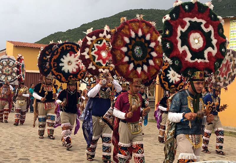 Feather dancers during a procession