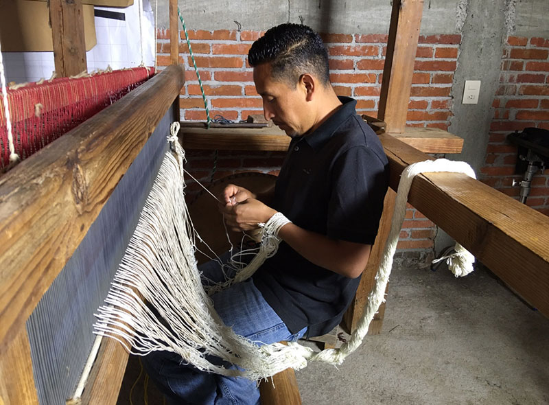 Porfirio working at the loom